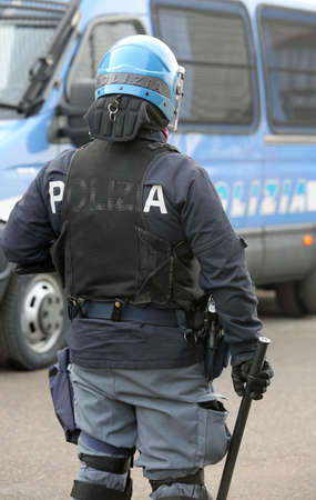 Italian police in riot gear with blue helmet and truncheon