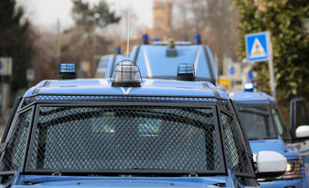 convoy with several police cars and armored vehicles on patrol to prevent terrorist attacks in the city Stock Photo