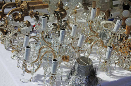 furnishings: old antique glass chandelier and crystal for sale in antiques market Stock Photo
