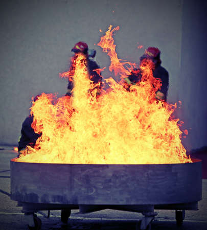 firefighters during the test of a fire extinguishing caused by a liquid gas spill Stock Photo