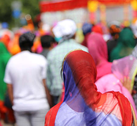kameez: Sikh women with veils over their heads during the festival sikh through the roads of the city Stock Photo