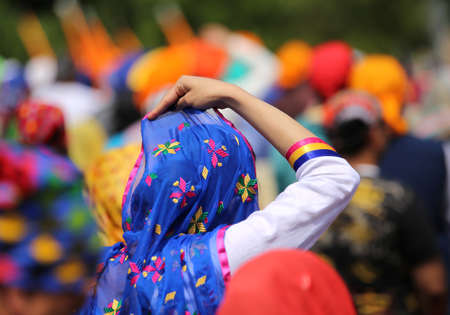 Sikh women with veils over their heads during the festival sikh through the roads of the city Stock Photo