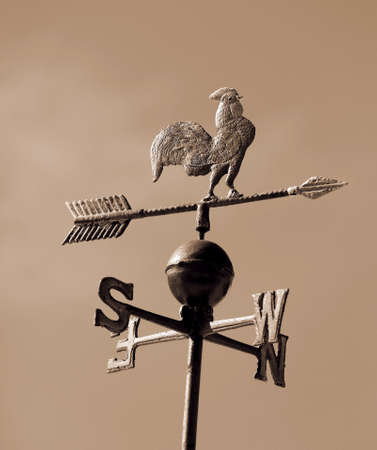 cardinal points: weathervane with sepia effect with arrow Foto de archivo