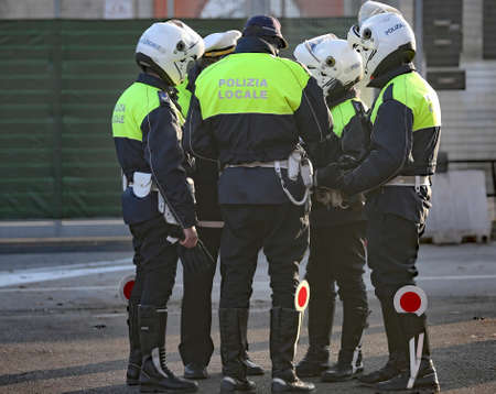 Italian police and some riders with helmet on his head during a roadblock