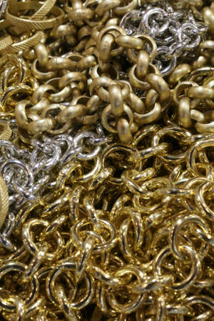 luxuriously: background of chains in gold and silver material
