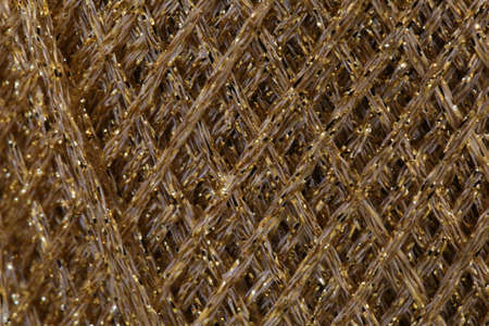 luxuriously: closeup background of many string in golden colors