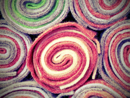 rolls of cloth and felt for sale in the shop with vintage effect