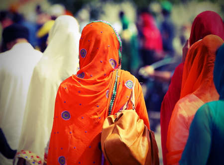 Sikh women with veils during the procession through the streets of the city