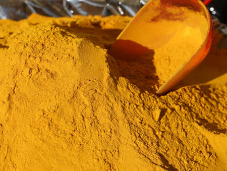 Turmeric Curry powder for sale and a red bailer Stock Photo