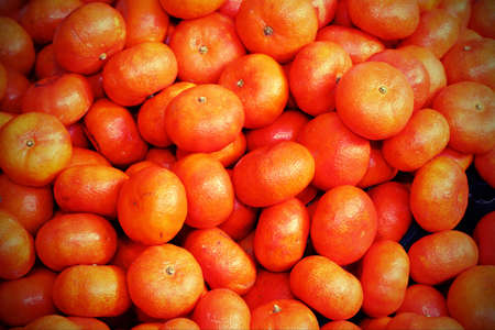 background of orange ripe mandarin for sale at the greengrocer Stock Photo