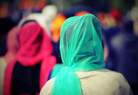 kameez: Sikh women with veils over their heads during the procession through the streets of the city