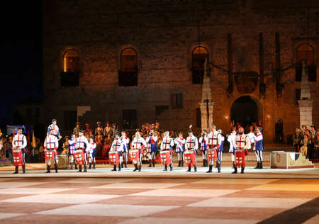 Marostica, VI, Italy - September 9, 2016: many drummers and the ancienct Castle by night Editorial