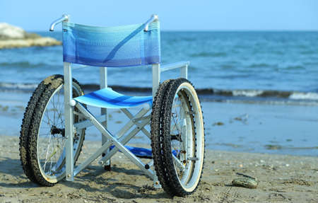 special wheelchair by the sea in summer with big wheels to go on the sand