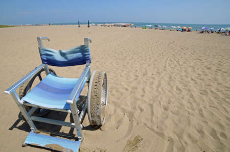 wheelchair with big steel wheels to go on the sand
