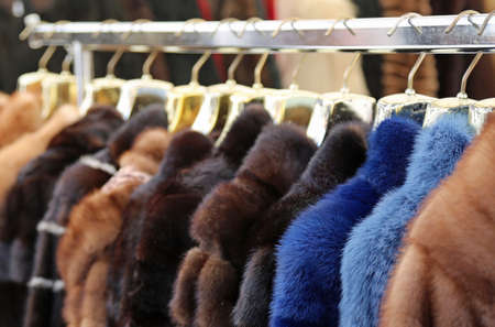 luxuriously: many clothes and furs for sale in the hanger in the local market