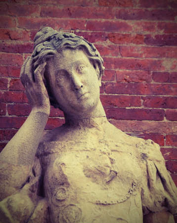 anthropomorphous: antique statue with a headache and hand on the face