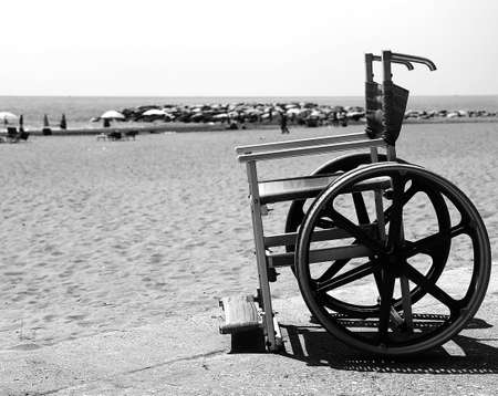 Wheelchair with stainless wheel on the beach in black and white effect