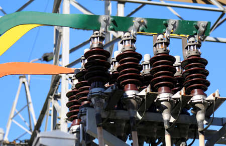 detail of ceramic insulators of a high-voltage transformer in the big power plant of solar energy production