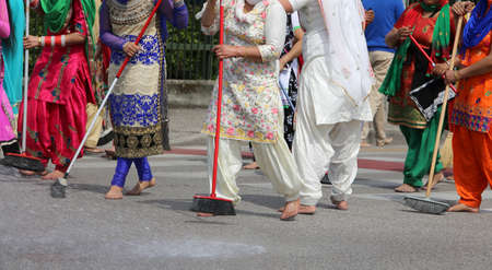 kameez: many Sikhs  women barefoot while scavenging the road during a Sikh festival