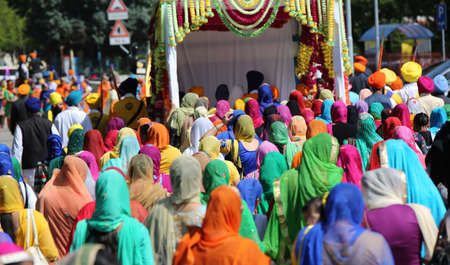 punjab: Vicenza, VI, Italy - April 8, 2017: many people Sikh procession pray during a religious ceremony Nagar Kirtan festival on the road Editorial