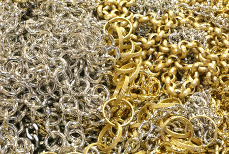 luxuriously: background of many chains in gold and silver material