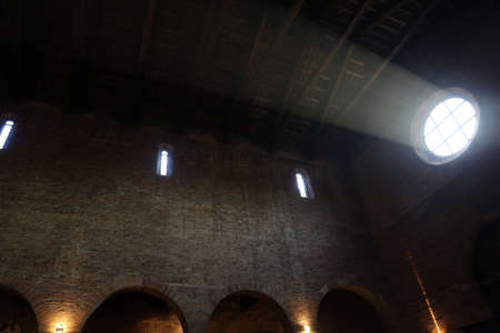 irradiation: Interior of an old church and the light that filters through the rose window