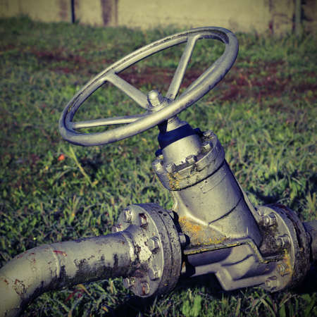 very big  shut-off valves in the refinery with vintage effect Stock Photo