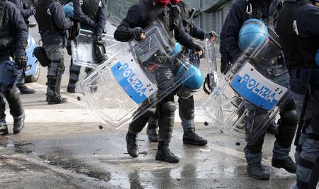 group of police with shields and riot gear during the event in the city