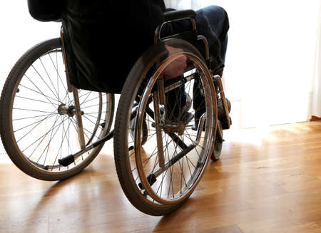 person with disability in the bedroom with parquet floor