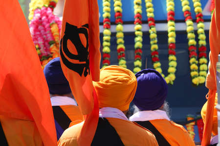 sikh men with flags during a cerimonial parade