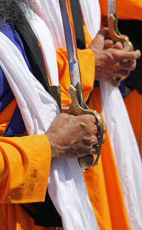 Detail of the hands of the Sikh religious men during the ceremony Stock Photo