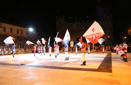 Marostica, VI, Italy - September 9, 2016: flag wavers during great show in the main square of town called Piazza degli Scacchi Editorial