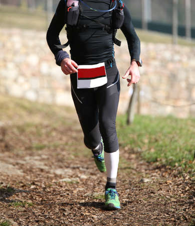 cross legs: man runs with sportwear during a cross-country race