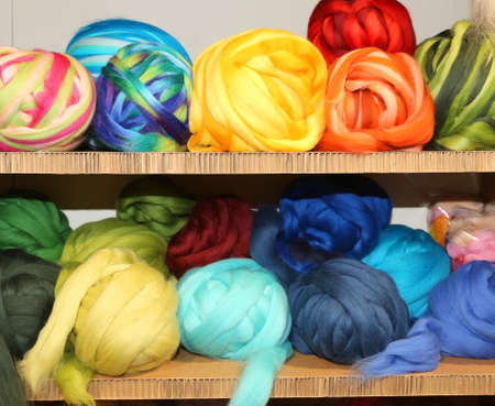 sale of balls of soft wool on the shelves of haberdashery