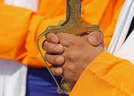 hand of soldier and hilt of the sword during the sikh event