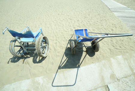 Modern wheelchair with big steel wheels and even a deckchair to bring disabled people on the beach