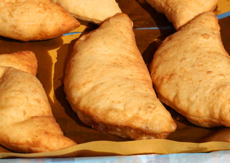 deatil: Deatil of italian stuffed fried bread called Panzerotti or Pizza Puff with tomato and cheese