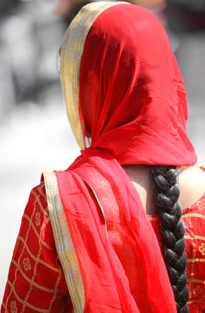 kameez: indian woman with long black hair and red veil