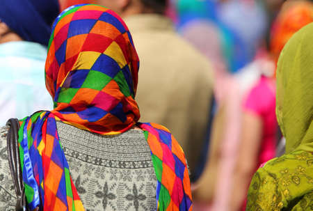 kameez: sikh women with multicolored veil during a religion ceremony outdoors