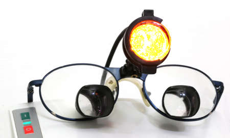 chirurgic: Special four-lens glasses with an infrared light spot for chirurgic operations in specialist clinical dentistry Stock Photo