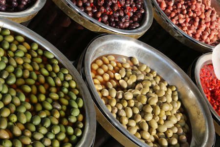 foggia: stall with Mediterranean olives and other products for sale in the local market