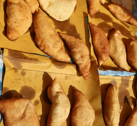 Many italian stuffed fried bread called Panzerotti or Pizza Puff with tomato and cheese Stock Photo