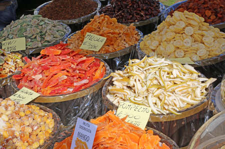 dried fruits for sale at the italian  market with the names of fruits in Italian and the price in Euros