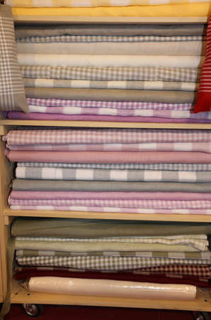 Inside the fabric store with many textile products for sale