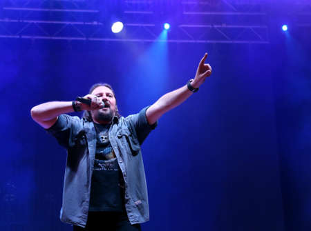 Bassano del Grappa, VI, Italy - April 29, 2017: Cilloni Yuri with the microphone is the vocalist of Nomadi an famous Italian Musical Band on the stage during the live concert in Italy