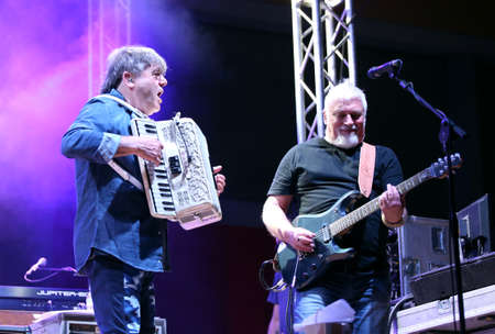 Bassano del Grappa, VI, Italy - April 29, 2017: Carletti Beppe plays the accordion and Falzone Cico guitar player  of Nomadi an Italian Rock Band on the stage during the live concert in Italy