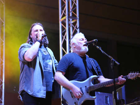 Bassano del Grappa, VI, Italy - April 29, 2017: Cilloni Yuri vocalist and Falzone Cico guitar player  of Nomadi an Italian Rock Band on the stage during the live concert Editorial