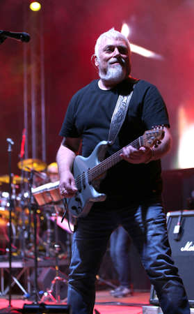 Bassano del Grappa, VI, Italy - April 29, 2017: Falzone Cico guitar player of Nomadi an Italian Musical Group on stage during a live concert