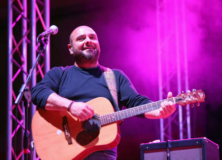 Bassano del Grappa, VI, Italy - April 29, 2017: Reggioli Sergio of Nomadi an Italian Musical Group plays the guitar during a live concert