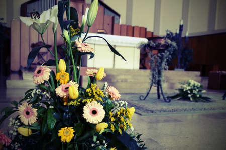 baptized: gerberas flowers and calla lilies at the baptismal celebration inside a european church